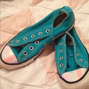 Teal converse with faded stripes